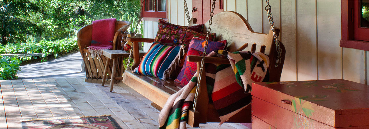 Swinging Bench on Red Cabin porch